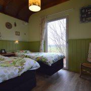 Pipowagen Juffertje in het Groen, slaapkamer met 2 bedden