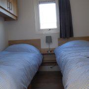 Skéép, woonkamer, kleine slaapkamer