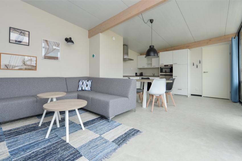 Qurios bloemendaal, woonkamer met open keuken