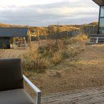Qurios, uitzicht vanuit Sea House Special, duinen en huisjes buren